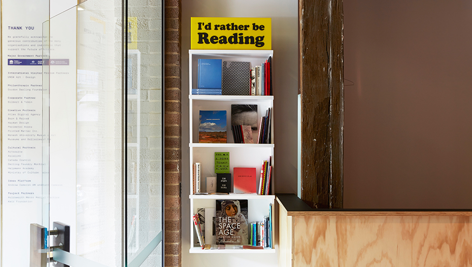 Printed Matter Inc. Curated Shelf, with Jeremy Deller's 'I'd Rather be Reading', screenprint on Plexiglass, 2013. Photo: Zan Wimberley 2015